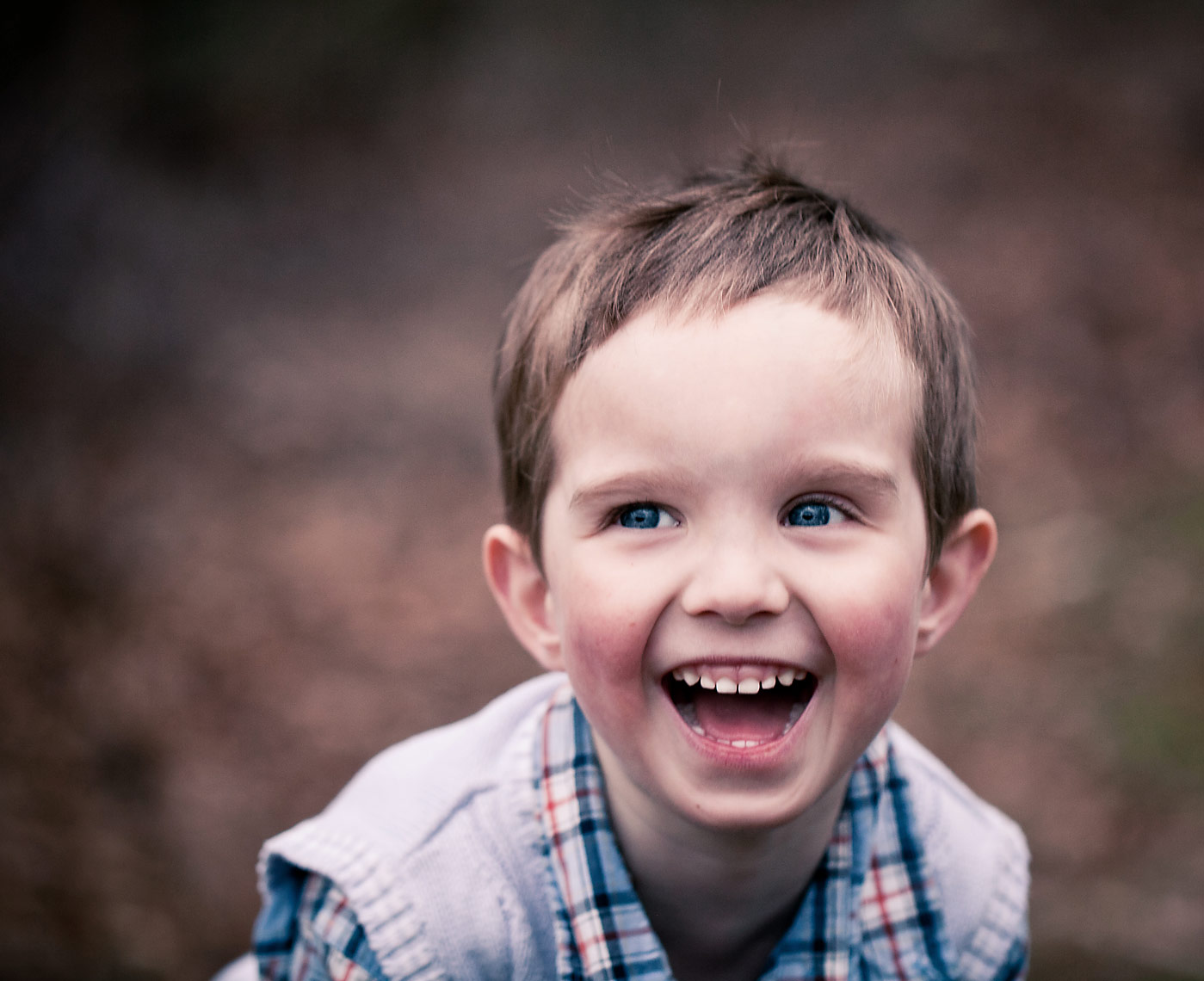 BOY LAUGHING IN FOREST.jpg